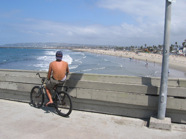 Not everyone was fishing. Some were just out enjoying the sunshine. A guy on a bike looks down on the busy beach.