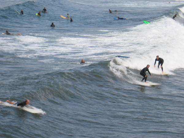 Below the pier, there seemed to be as many surfers as mackerel in the ocean.