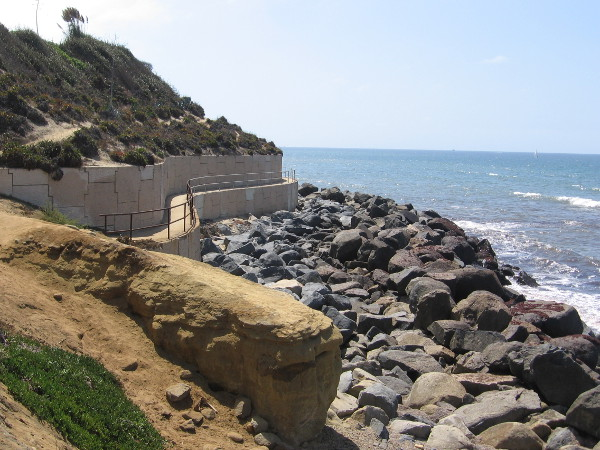 Now we're approaching an interesting part of the walk, with a short, undulating path along a sea wall.