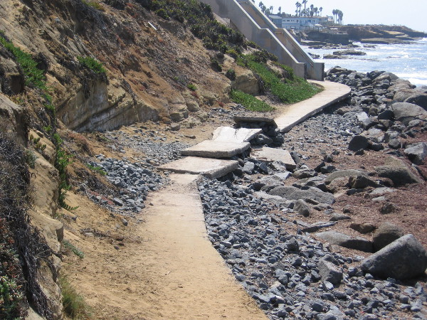 We've almost reached the end of our walk. The concrete pathway ahead has either been undermined by water, or intentionally made into a ramp for thrill seekers.