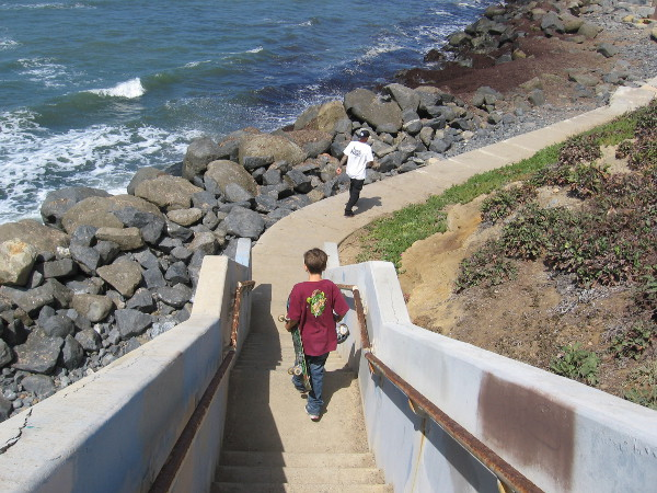 Two people begin their own adventure along the rocks.