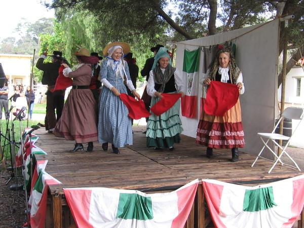 Traditional dances were being performed on the central plaza's main stage. Las damas y los caballeros took turns being el toro and el matador!