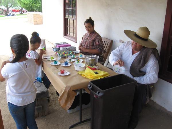 Kids were decorating traditional cascarones eggshells.