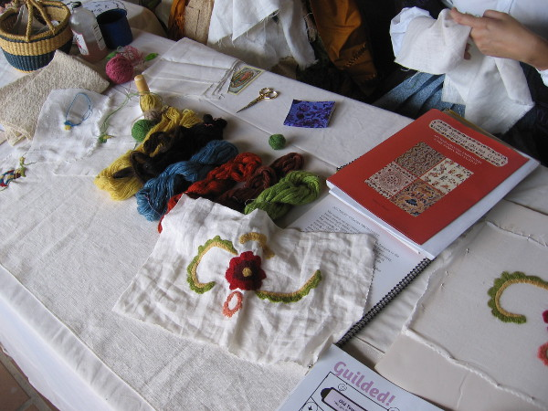 Nearby, ladies were demonstrating Colcha Spanish Colonial embroidery, which was typical in San Diego in the early 1800s.