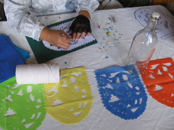 At the same table, another lady was cutting out festive Mexican papel picado.