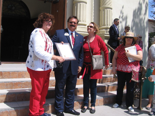 Kathleen Winchester, historian of the San Diego Chapter of the Daughters of the American Revolution, is presented with an official proclamation on Constitution Day.