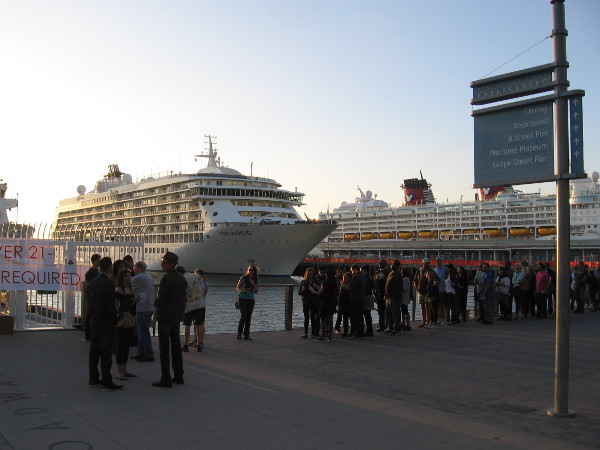 The World and the Disney Wonder at dock in San Diego.