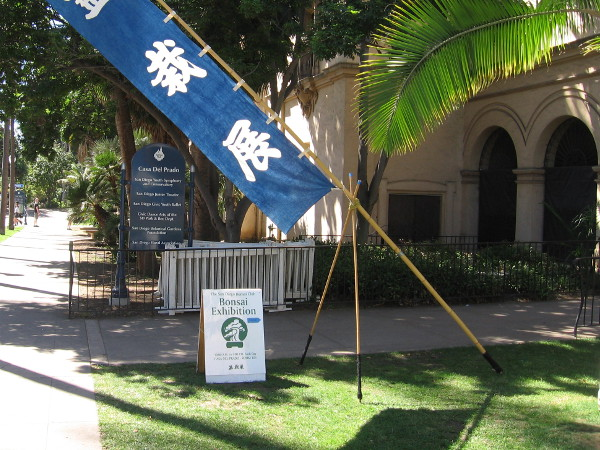 A sign outside the Casa del Prado directs visitors to an exhibition by the San Diego Bonsai Club.