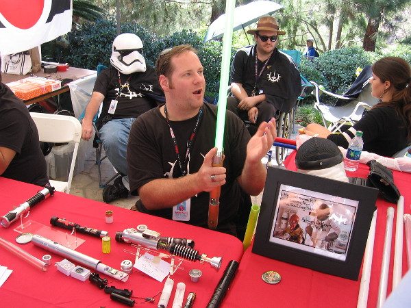 This member of the San Diego Sabers has personally made many lightsabers. Some examples lie on the group's table during Maker Faire in Balboa Park.