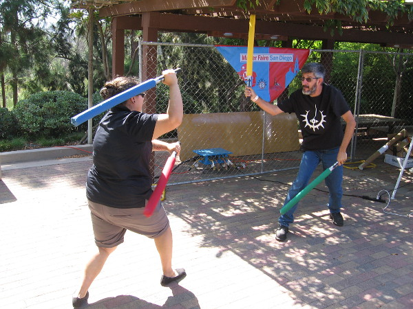 Members of the San Diego Sabers demonstrate mock combat using foam attachments. Together they've got enough lightsabers to take on General Grievous!
