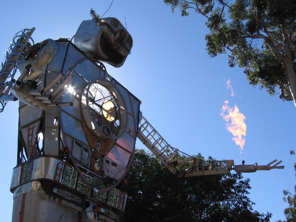Flames rise from the fingertips of Robot Resurrection at 2017 Maker Faire San Diego in Balboa Park.