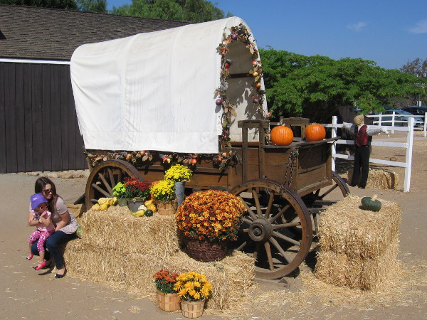 A covered wagon in Old Town San Diego State Historic Park is decorated with fall colors in October.