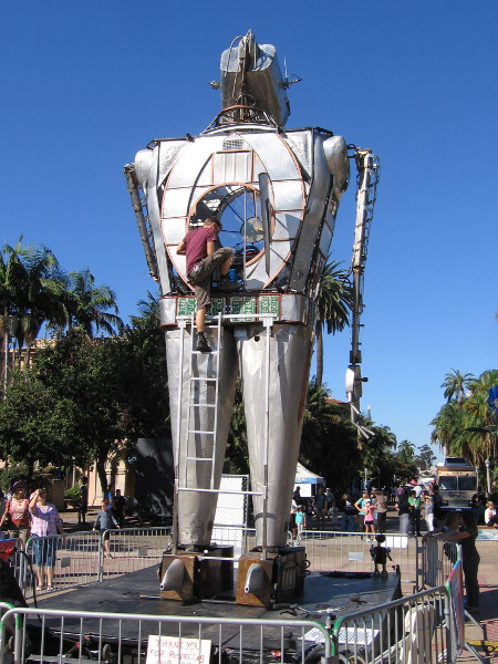 A human operator emerges from the chest of the gigantic flame-throwing robot!