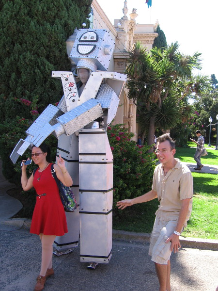 A performance artist becomes a fun robot. People walking down El Prado posed for photos!
