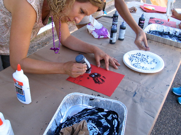 The Timken Museum of Art had a table that helped kids learn how to make some cool Halloween artwork.