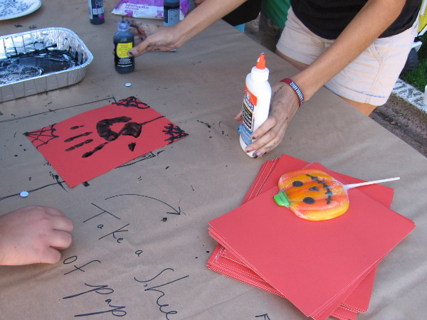A scary hand print and nearby smiling pumpkin treat.