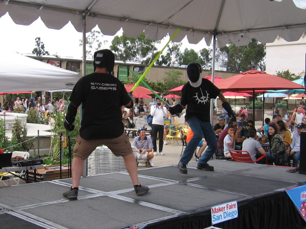 As Star Wars music plays, two members of the San Diego Sabers simulate an epic battle between the Jedi and Sith.