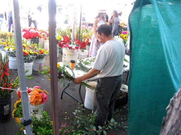Flower vendor at the Saturday Little Italy Mercato Farmers' Market.