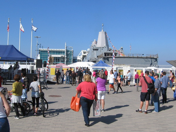 People fill the Embarcadero near the Broadway Pier during Fleet Week.