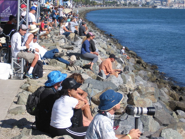 A crowd watches the free Ultimate Stadium Racing Championship event from Harbor Island's festive Race Village.