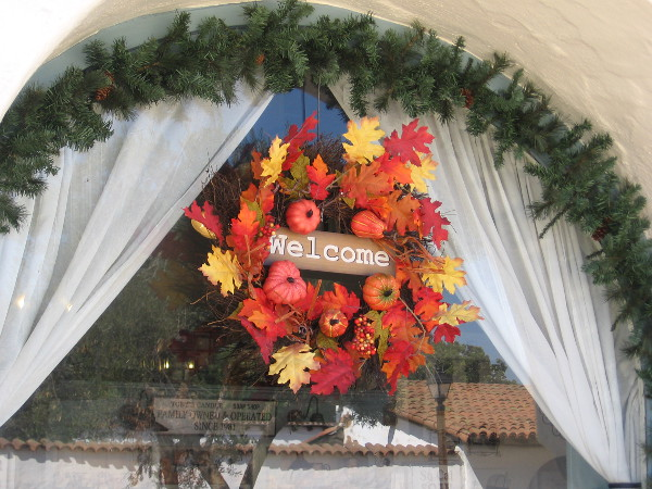 Colorful leaves and a bountiful harvest frame the Welcome in an Old Town shop window.