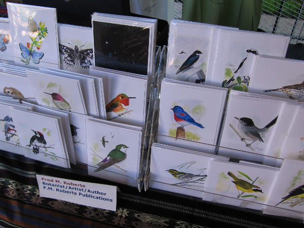 Fred Roberts, a local botanist, artist and author had some of his beautiful bird art for sale at one end of the long table.