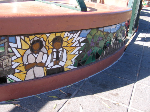 Scenes of Hispanic life, culture and history decorate benches and seats at a San Diego Trolley station.