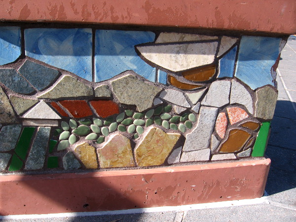 Beautiful abstract mosaic. Tiles of different colors, sizes and shapes.