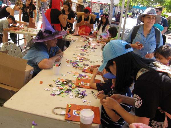 Decals were being applied to trick-or-treat bags in Spanish Village Art Center.