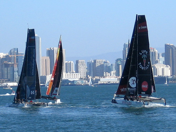 Beautiful sailboats do battle on San Diego Bay, with the downtown skyline providing a picturesque background.