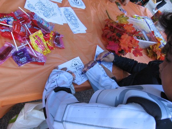 More fun Halloween coloring at the International Cottages table on El Prado.