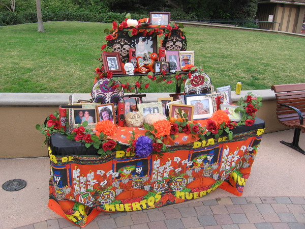 A Dia de los Muertos altar remembers and celebrates those who've passed out of life. Their spirits are enticed to return among the living.