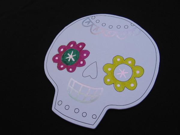 At one table creative kids could color Dia de los Muertos skulls.
