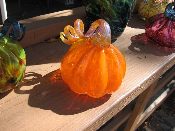 A beautiful glass pumpkin, that was made by the glassblowers of Spanish Village.