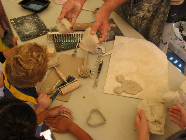 Kids learn how to sculpt in Spanish Village during Halloween Family Day.