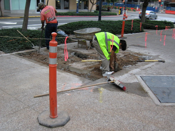 Working on the sidewalk early Friday morning. Always more to do.