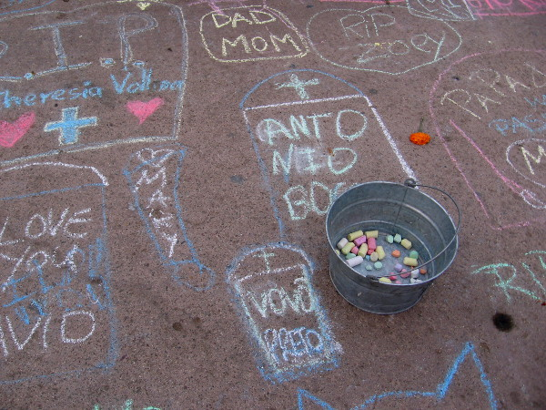 Names and a few loving words. Spiritual magic, linking the living with the dead during Dia del Los Muertos.