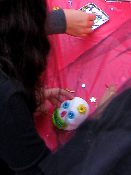 Children decorate traditional sugar skulls.