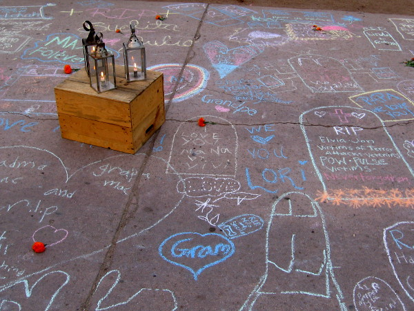 Lanterns among the heartfelt Dia de los Muertos chalk memorials.