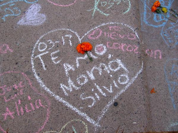 Te amo--I love you--and a marigold.