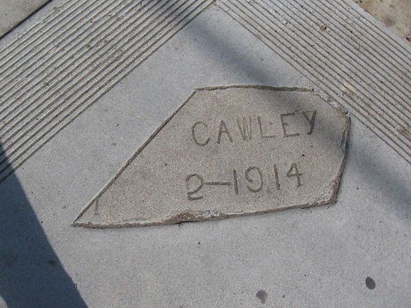 A fragment of sidewalk remains from 1914.
