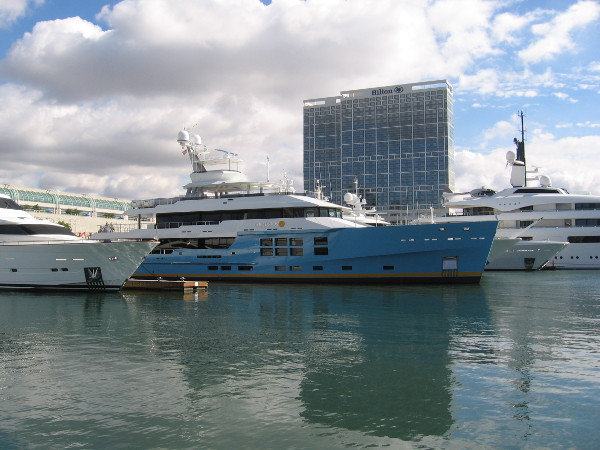 The brand new, blue-hulled luxury superyacht Chirundos among other impressive ships docked in San Diego in late 2017.