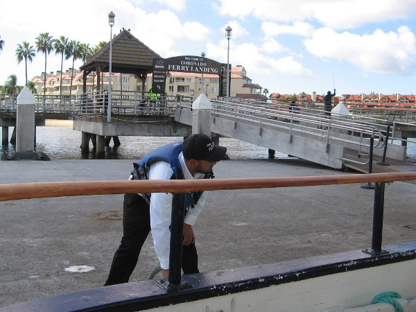 Flagship employee ties up the Silvergate at the Coronado Ferry Landing.