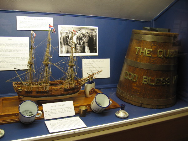A display features an explanation of grog and rum on British Royal Navy ships. Grog was rum diluted with water to prevent drunkenness. The grog ration was abolished in 1970.