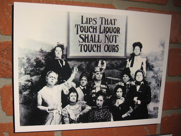 A photograph of anti-alcohol activists taken during Prohibition. Lips that touch liquor shall not touch ours!