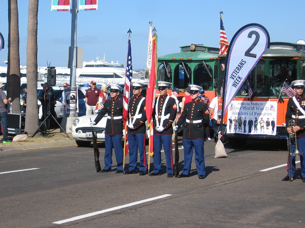 The color guard awaits the start of the big parade down Harbor Drive.