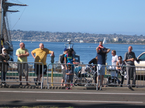 Many would watch the parade from across Harbor Drive, near the Maritime Museum of San Diego.