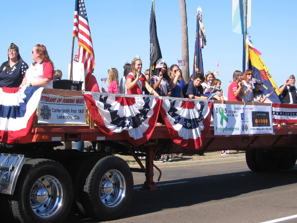 Beauty queens wave, representing the Veterans of Foreign Wars post in Lakeside.