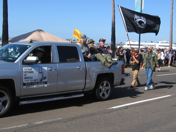 A POW MIA flag follows a group of honored Veterans.