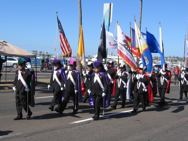 The San Diego Diocese Chapter of Knights of Columbus marches past.